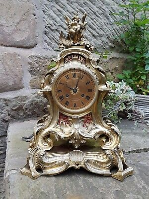 A magnificent Louis XV style gilded bronze mantel clock by Raingo Freres - 1820
