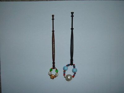 A very lovely pair of bobbins in dark wood and hand turned