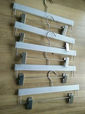 5 Silver and perspex mix trouser hangers.