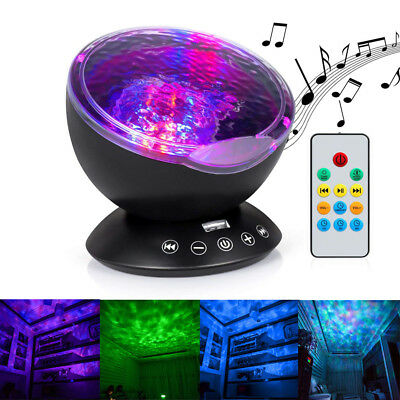 Remote Control Ocean Wave Projector 12 LED 7 Color Night Light Music Player Xmas