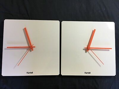 2 Wall Clocks by KARTELL Both White with Orange Hands