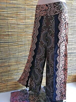 Bulk lot of 5 rayon wrap look pants.Elastic back waist.Popular print design.Cool
