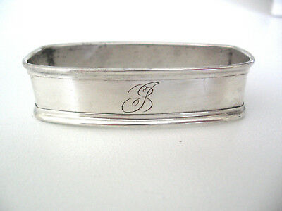 "Clean sterling silver napkin ring engraved with the letter ""J"""