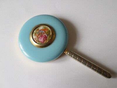 Small vintage enamel backed hand mirror with courting scene plaque