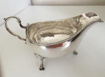 Outstanding beaded Georgian Irish sterling silver gravy or sauce boat