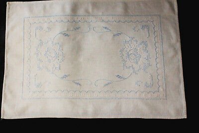 Vintage off-white tray cloth with blue hand embroidery.