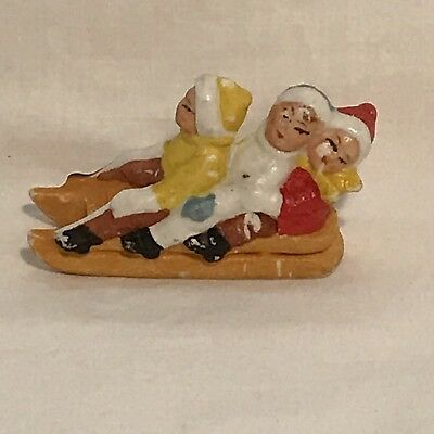Miniature Bisque 3 Children On A Sled