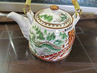 Oriental Teapot with Wooden Handle
