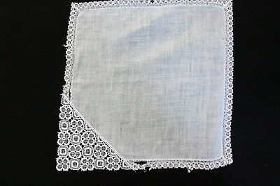 Ladies white linen handkerchief with lace corner. Suitable for craft work.