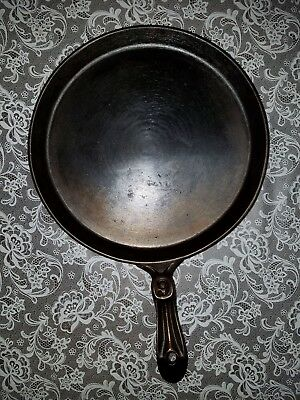 Very light Cast Iron Number 9 Griddle W/ Ornate Handle And Heat Ring