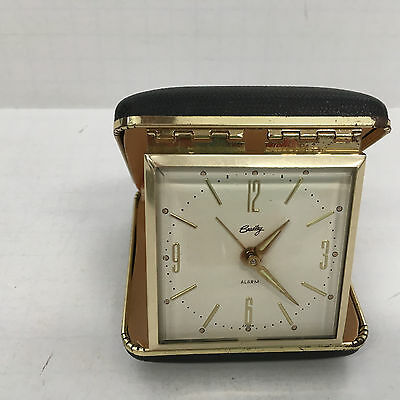 vintage wind up travel alarm clock in hard case sold as is for parts
