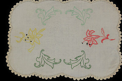 Vintage beige linen cloth with hand embroidered yellow and coral pink flowers.