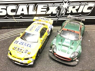 Two Scalextric Cars 1/32 Nissan Skyline And Aston Martin Used