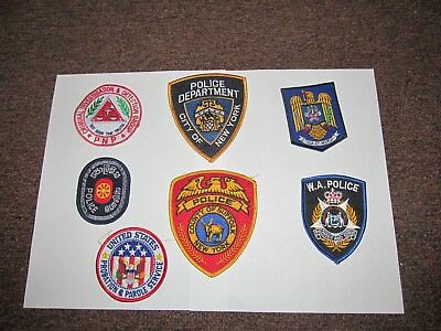 Lot of Seven New U.S. and International Police Patches