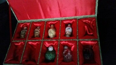 group of  7 Chinese snuff bottles and red  silk lined box