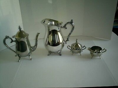 Wm Rogers silver plated footed lipped water pitcher and 3 piece Tea set