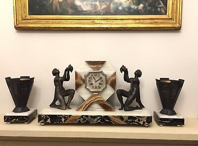 Art Deco Clock With A Pair Of Garnitures Sculpture By Limousin