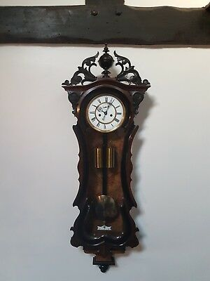 A superb carved twin weight Vienna wall clock (circa 1870) Germany