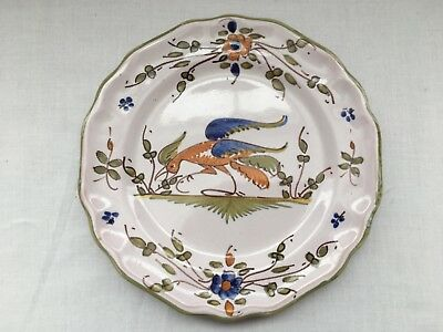French Faience Moustier plate with Cock design. Marked MF 4/9
