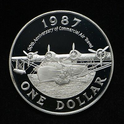 1987 Bermuda Silver One Dollar 50th Anniversary (chip out of cap)(cn6002)
