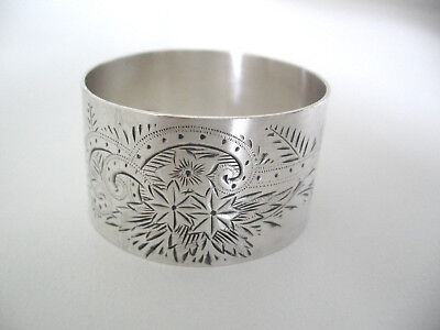 Very ornate Sterling silver napkin ring with bright cut decorations. No monogram