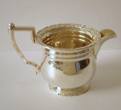 An Ornate Heavy Sterling Silver Small Cream Jug Sheffield 1902 130 Grams