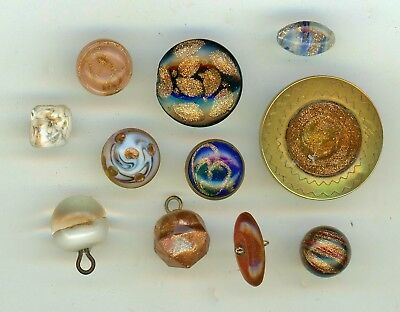 11 Buttons with goldstone.  In metal, faceted, popper, paper weight, pin shank