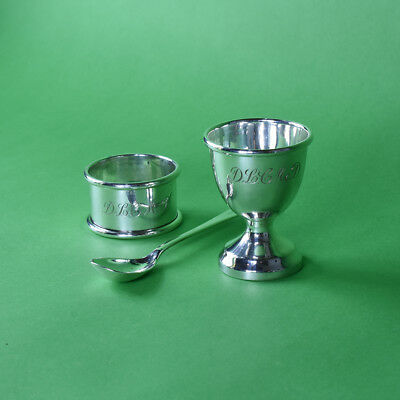 Very Pretty Set of Sterling Silver Napking Ring, Egg Cup and Spoon in a Silk Box