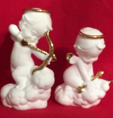 Two White Ceramic Angel Figures with Gold Trim Holding Bow and Arrows