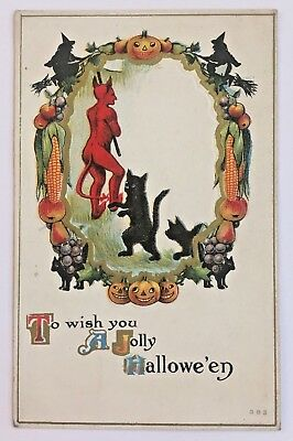 Antique Halloween Postcard Devil Witch Black Cat Wreath of Fruit Vegetables 383