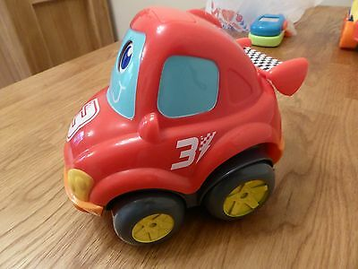 Red car vehicle toy wobbles along