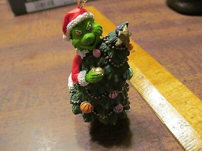 Seuss Grinch with decorated chritmas tree ornament