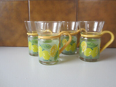 4 Lemon Tea Glasses with Holders by Inspiration 12cms high width 6cms.