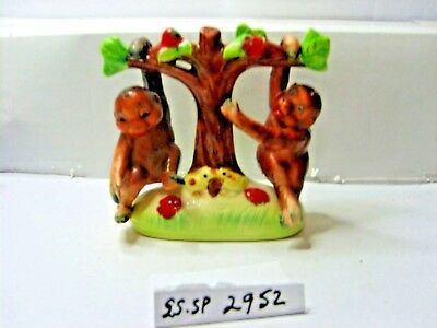 monkeys hanging in tree  salt and pepper shakers