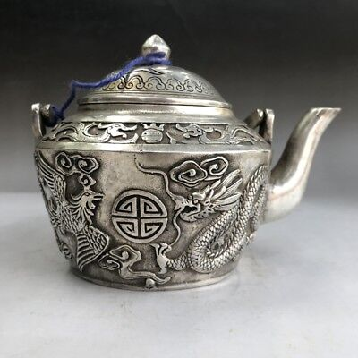 ancient Tibetan silver wine pot pure hand carved dragon and phoenix image.