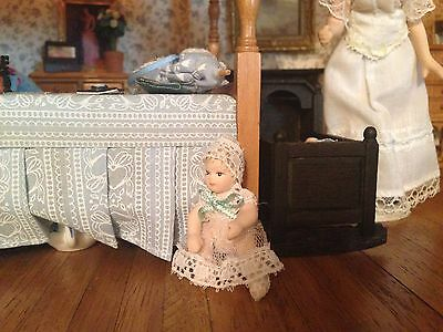 1:12 Scale Dolls House child baby girl IN LACY DRESS nursery accessory