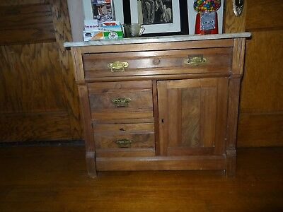 Eastlake washstand with original hardware and marble top