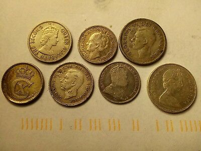 old silver coins from canada,netherlands, austrailia, denmark and british borneo