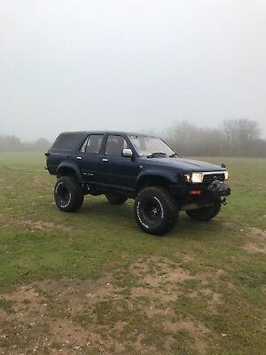 Toyota Hilux surf off road 4x4 lifted monster truck snow mud