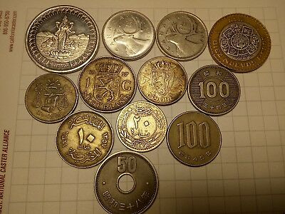 12 world coins various silver content and more...