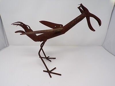 Vintage welded metal yard art bird rustic garden tools