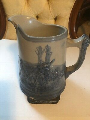 """Stoneware Pitcher With Unique Indian Scenes; 7.5"""" High By 5"""" In Diameter."""