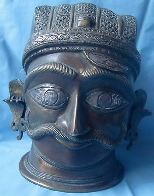Old brass statue of hindu god shiv face head with copper silver carved figurine