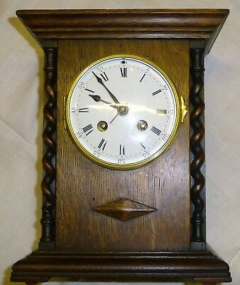 Mantel clock by L Marti France striking the half and full hour