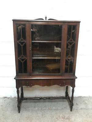 antique bookcase on stand
