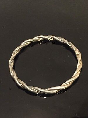 Vintage solid white metal bangle with rope twist design .800 or higher