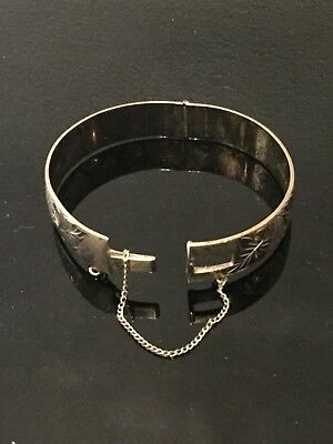 Vintage silver bangle with safety chain Birmingham 1971