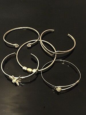 Five vintage Sterling silver and white metal bangles