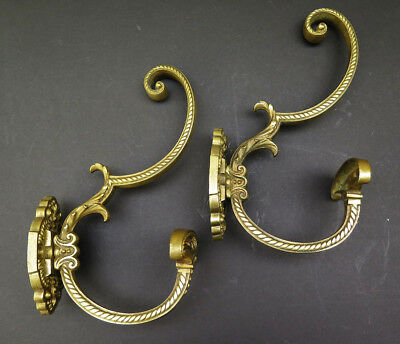 A Pair Of Ornate Antique  Brass Coat Hooks