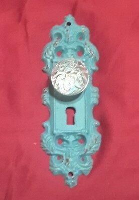 One Cast Iron decorative door plates, swirl knobs  teal gold highlights